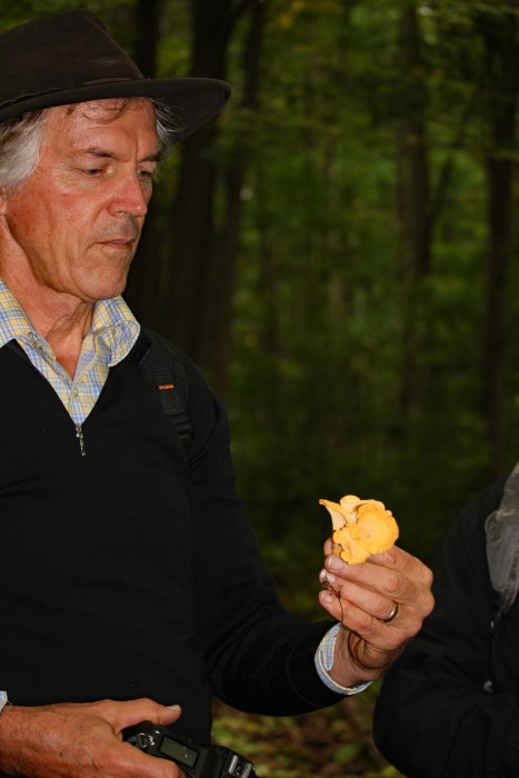 Eric holds an edible find- Chanterelles.